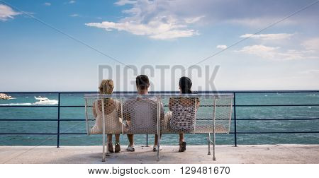 Three amigos watching the boats go by