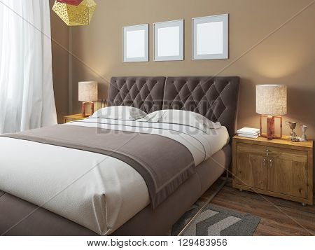 Luxury large modern double bed in the bedroom loft style. Bed linen in white and brown colors. Above the bed three mockup. On the sides are two bedside tables with lamps. 3D render.