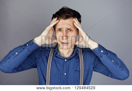 young goofy man with pimples pointing in studio, stupid bookwarm little crazy