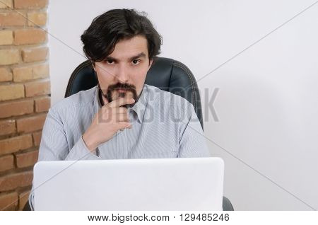 Portrait Of Attractive Serious Businessman Working At The Office