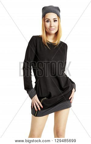 Portrait Of Girl In A Black Mini Dress And Cap