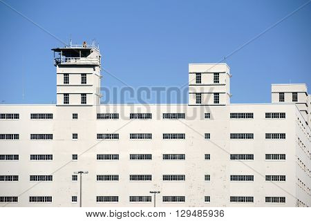 SAN DIEGO, UNITED STATES - DECEMBER 25: The bright angular exterior facade of the Naval Base San Diego with watchtowers on December 25, 2015 at the Navy Pier in San Diego.