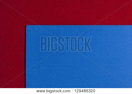 Eva foam ethylene vinyl acetate blue surface on red sponge plush background