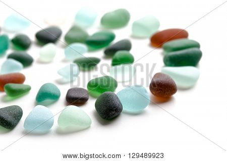 glass pieces polished by the sea closeup on white background