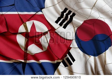 Flag of South Korea and North Korea on a cracked paint wall. A sign of conflict between 2 nations Seoul and Pyongyang after atomic nuclear test and several missile rocket launch by Kim Jong-un forces