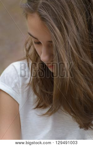 Portrait of a young girl covering face long hair