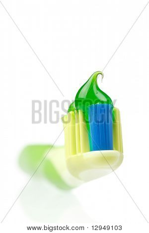 Tooth Paste on the green Dental Brush