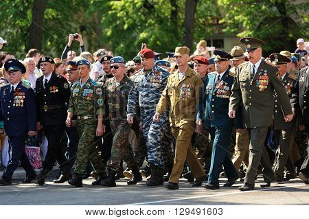 Orel Russia - May 9 2016: Celebration of 71th anniversary of the Victory Day (WWII). Russian Afganistan war veterans marching in parade horizontal