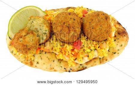 Fried falafels on a naan bread with couscous and fresh lime wedges isolated on a white background