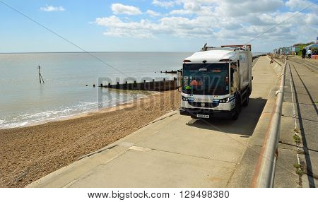 FELIXSTOWE, SUFFOLK, ENGLAND - MAY 03, 2016: Refuse collection truck on seafront promenade Felixstowe Suffolk England.