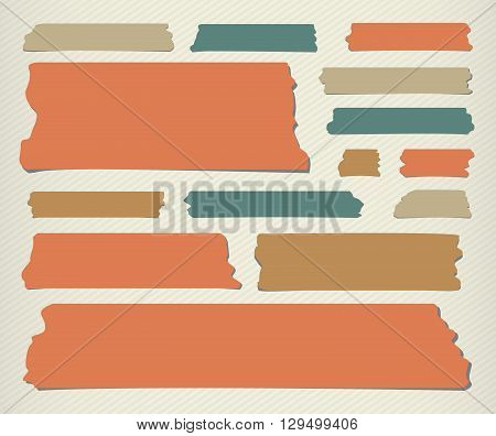 Set of colorful different size sticky, adhesive tape, banners pieces are stuck on lined wall.