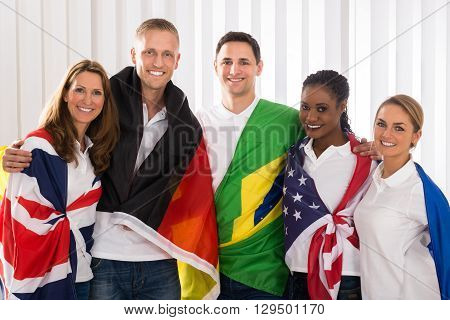 Group Of Happy Patriotic People With Flags From Different Countries