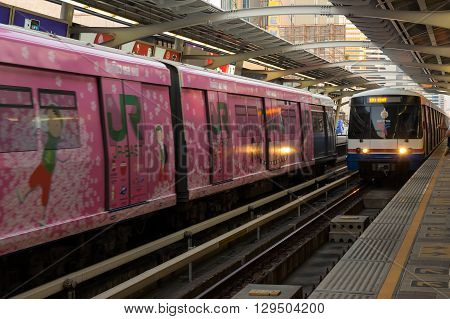 BANGKOK THAILAND - FEBRUARY 05 2015: BTS train arriving at station. BTS or the Skytrain is an elevated rapid transit system in Bangkok Thailand