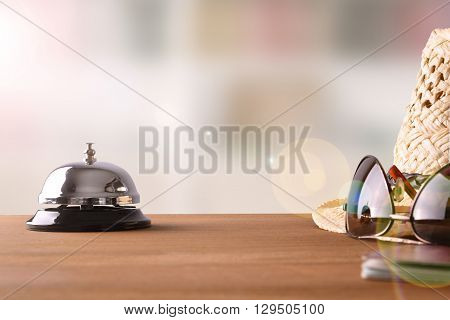 Tourist Objects On Wood Table Of Hotel Reception Front View