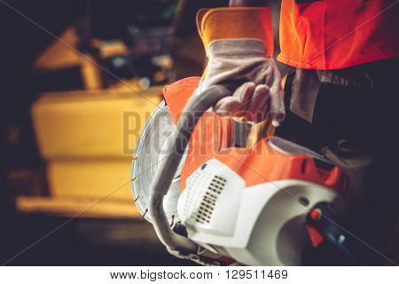 Stone Cutter Works. Construction Worker with heavy Duty Cutter.