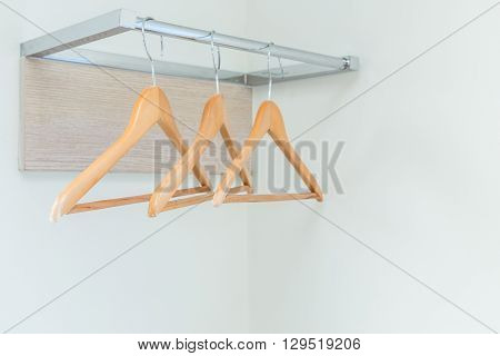 Wooden Cloth Hangers On The Wall In Hotel Room