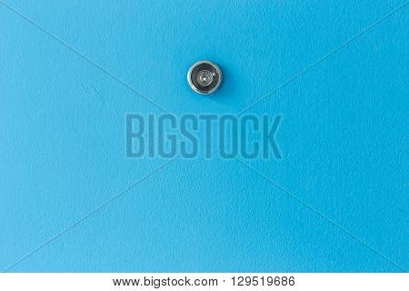 Door Lens Peephole On Blue Wooden Texture
