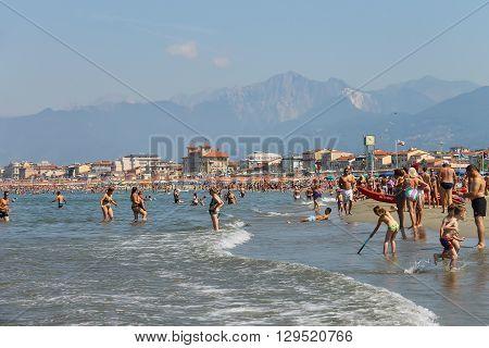 Viareggio Italy - June 28 2015: People resting on the beach. Viareggio is the famous resort on the coast of the Ligurian Sea
