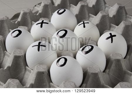 WIN. Drawing on white eggs - tic-tac-toe game