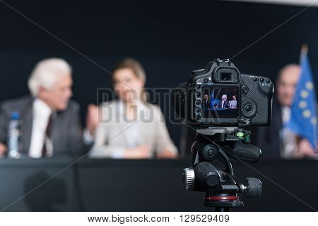 Close-up of video camera in a conference room