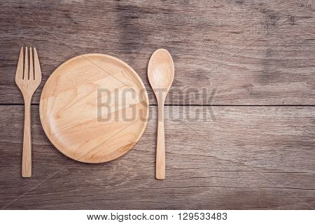 Wooden Dish And Spoon On Wooden Table Top View
