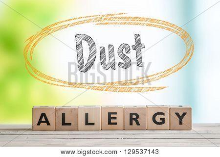 Dust Allergy Headline On A Wooden Table
