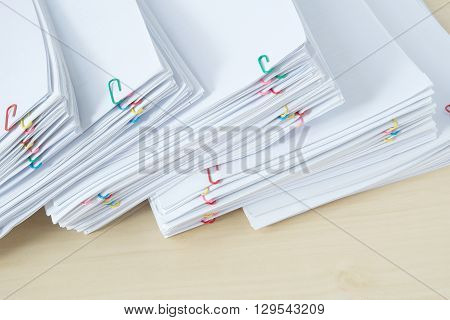 Pile Of Workload Paper And Reports With Colorful Paper Clip