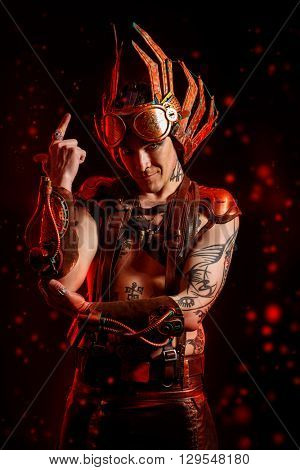 Fire steampunk man with a mechanical devices. Fantasy. Hephaestus.