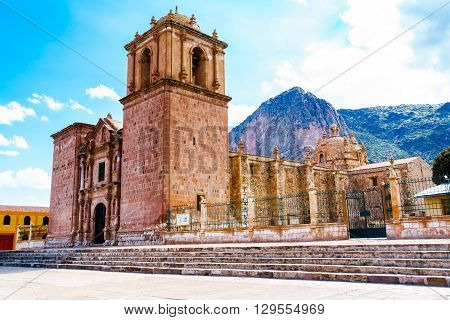 Bell Tower of Pupuka Church in Pukara with ceramic cow at the fence in Peru