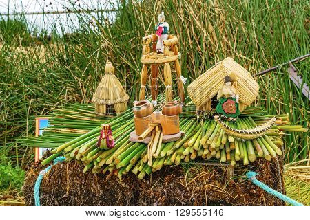 Model of the Floating Island and the house of Uru people at Los Uros in Lake Titicaca Puno Peru