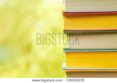 Stack of old books on the green background