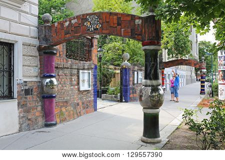 VIENNA AUSTRIA - JULY 12: Tourists Going in Hundertwasser Museum in Wien on JULY 12 2015. People in Front of Kunst Haus Wien Museum Designed by Artist Friedensreich Hundertwasser in Vienna Austria.