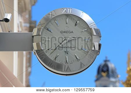 VIENNA AUSTRIA - JULY 11: Omega Clock Sign in Wien on JULY 11 2015. Omega Constellation Watch Sign With Silver at Building in Vienna Austria.