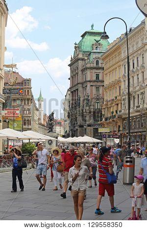 VIENNA AUSTRIA - JULY 12: People at Graben Street in Wien on JULY 12 2015. Pedestrians Walking at Main Shopping Street in Vienna Austria.