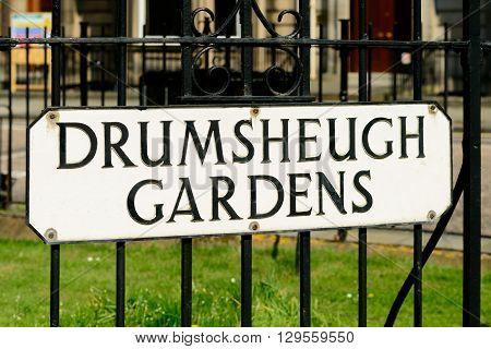 Street sign for Drumsheugh Gardens prime residential property in Drumsheugh Gardens in the west end of Edinburgh.