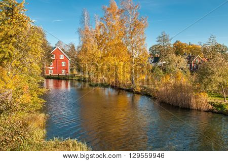 Motala river during autumn in Borensberg, Sweden. The river drains Lake Vattern into the Baltic sea.