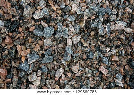Pattern of the wet dark gravel surface