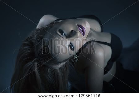 Portrait of beautiful provocative blonde female model