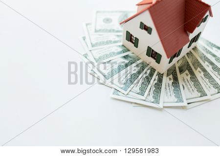 building, mortgage, investment, real estate and property concept - close up of home or house model and money poster