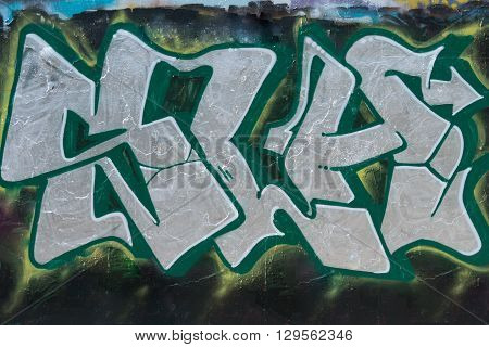 Wall painted grafitti, green with silver letters