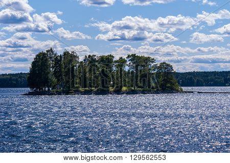 Island in bright sunlight with glittering water