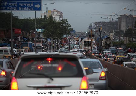 Mumbai, India - July 17 2015: A very slow moving traffic jam on a cloudy evening in Mumbai India