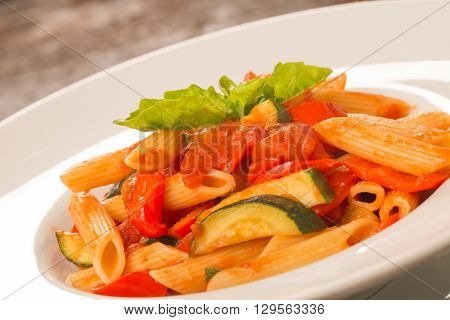 Close Up Of Pasta With Tomatoes, Zucchini And Basil