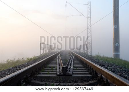 Sunrise and morning mist over the railway