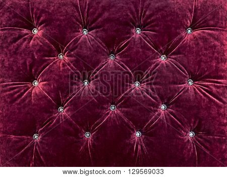 Texture of upholstered furniture, decorated with rhinestones