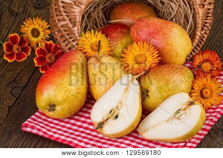 Ripe pears decorated on a rustic background.