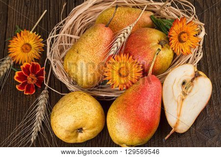 Pears on old wooden background. Flat lay, Top view.