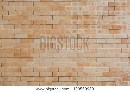 dirty brown brick wall with sharp edge brick
