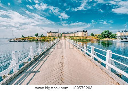 Wooden Bridge Leading To Buildings Of Former Barracks On Territory Of Naval Suomenlinna Fortress Near Helsinki, Finland. Sunny Day With Blue Sky.