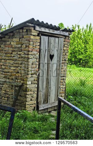 Old rural toilet in an extra yard.